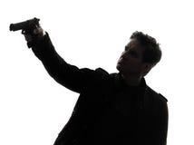 Manmördarepolis som siktar vapenkonturn royaltyfri fotografi
