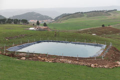 The manmade pool for agriculture by using plastic sheet Royalty Free Stock Image