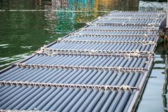 Manmade synthetic plastic pipe floating pontoon for supporting a variety of marina dock systems including harbors, flotation docks. Rafts over water background stock images