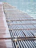 Manmade synthetic plastic pipe floating pontoon for supporting a variety of marina dock systems including harbors, flotation docks. Rafts over water background royalty free stock photo