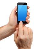 Mann übergibt Holding smartphone Stockbild