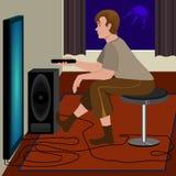 Mann-überwachendes Fernsehen Lizenzfreies Stockbild