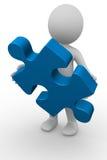 Mann 3D mit einem Puzzlespielstück Lizenzfreies Stockbild