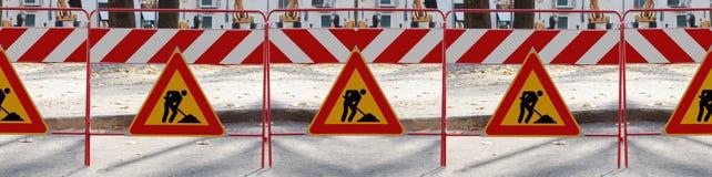 Mann 6 an den Arbeit Verkehrsschildern Lizenzfreie Stockbilder