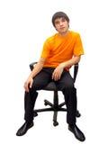 Mann auf dem Stuhl Stockfotos