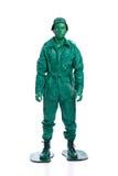 Mann auf einem grünen Spielzeugsoldatkostüm Lizenzfreies Stockbild