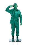 Mann auf einem grünen Spielzeugsoldatkostüm Lizenzfreie Stockfotografie
