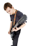 Mann auf einem weißen Hintergrund Ausführender mit einer elektrischen Gitarre lizenzfreie stockbilder