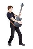 Mann auf einem weißen Hintergrund Ausführender mit einer elektrischen Gitarre Stockfotografie