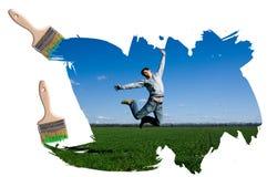 Mann auf Feld und blauem Himmel Stockfoto