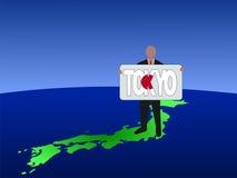 Mann auf Karte von Japan Stockfotos