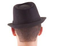 Mann auf seinem zurück mit einem schwarzen Hut ein lizenzfreies stockfoto
