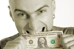 Mann-beißendes Dollarschein Lizenzfreie Stockbilder
