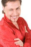 Mann blinzelt an der Kamera Lizenzfreie Stockbilder