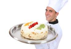 Mann-Chefholding Kuchen (Fokus auf Mann) Stockbilder