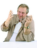 Mann in den fünfziger Jahren mit einem Handgestikulieren Stockbild