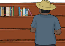 Mann in den Hut-Grasenbüchern Lizenzfreies Stockfoto