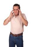 Mann in den Schmerz mit Kopfschmerzen Stockbild