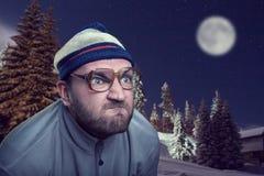 Mann in den Winterbergen Stockfotografie