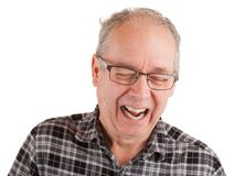Mann, der über etwas lacht stockbild