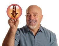 Mann, der auf Downloadikone zeigt Lizenzfreie Stockbilder
