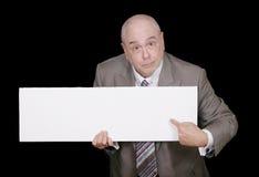 Mann, der auf unbelegtes Zeichen zeigt Lizenzfreie Stockbilder