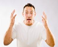 Mann, der in Überraschung gestikuliert Lizenzfreies Stockfoto
