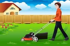 Mann, der den Rasen mäht lizenzfreie abbildung