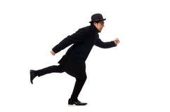 Mann, der den schwarzen Mantel lokalisiert auf Weiß trägt stockfotografie
