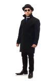 Mann, der den schwarzen Mantel lokalisiert auf Weiß trägt Lizenzfreies Stockbild
