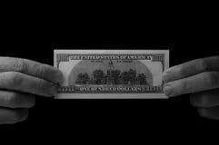 Mann, der 100 Dollarschein hält Lizenzfreies Stockfoto