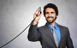 Mann, der ein Diagramm auf dem Schirm zeichnet Stockbild