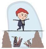 Mann, der ein Drahtseil walkking ist Lizenzfreie Stockfotos
