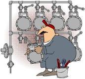 Mann, der ein Gas-Messinstrument ändert Stockbild