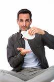 Mann, der ein leeres Sparschwein zeigt Stockfotos