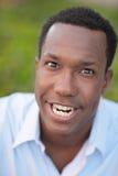 Mann, der ein ungewöhnliches Gesicht bildet Stockfotos