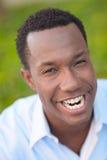 Mann, der ein ungewöhnliches Gesicht bildet Lizenzfreies Stockbild