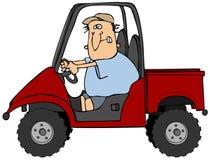 Mann, der ein UTV Fahrzeug antreibt Lizenzfreie Stockfotos