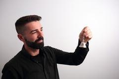 Mann, der eine Glocke schellt Stockbilder