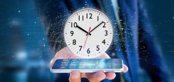 Mann, der eine Wiedergabe des Uhrtimers 3d hält Lizenzfreie Stockfotos