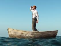 Mann, der in einem Boot treibt Lizenzfreie Stockfotografie