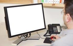 Mann, der an einem Computer arbeitet Stockbild