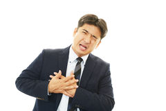 Mann, der einen Herzinfarkt hat Stockfoto