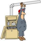 Mann, der einen Ofen installiert Stockfotografie