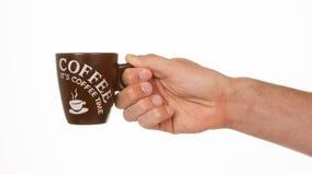 Mann, der einen Tasse Kaffee hält stockfotos