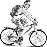 Mann, der einen Zyklus reitet Stockfotografie