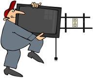Mann, der Flatscreen Fernsehapparat installiert Lizenzfreies Stockfoto
