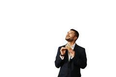 Mann, der Geld zählt und oben schaut Lizenzfreies Stockfoto