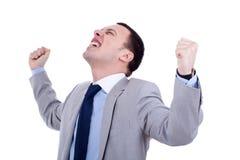Mann, der in gewinnender Haltung steht Stockfotografie