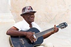 Mann in der Gitarre Havana Stockfotos
